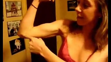 Bridget flexing her biceps