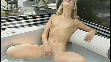 Skinny blonde girl plays with herself in bubble bath